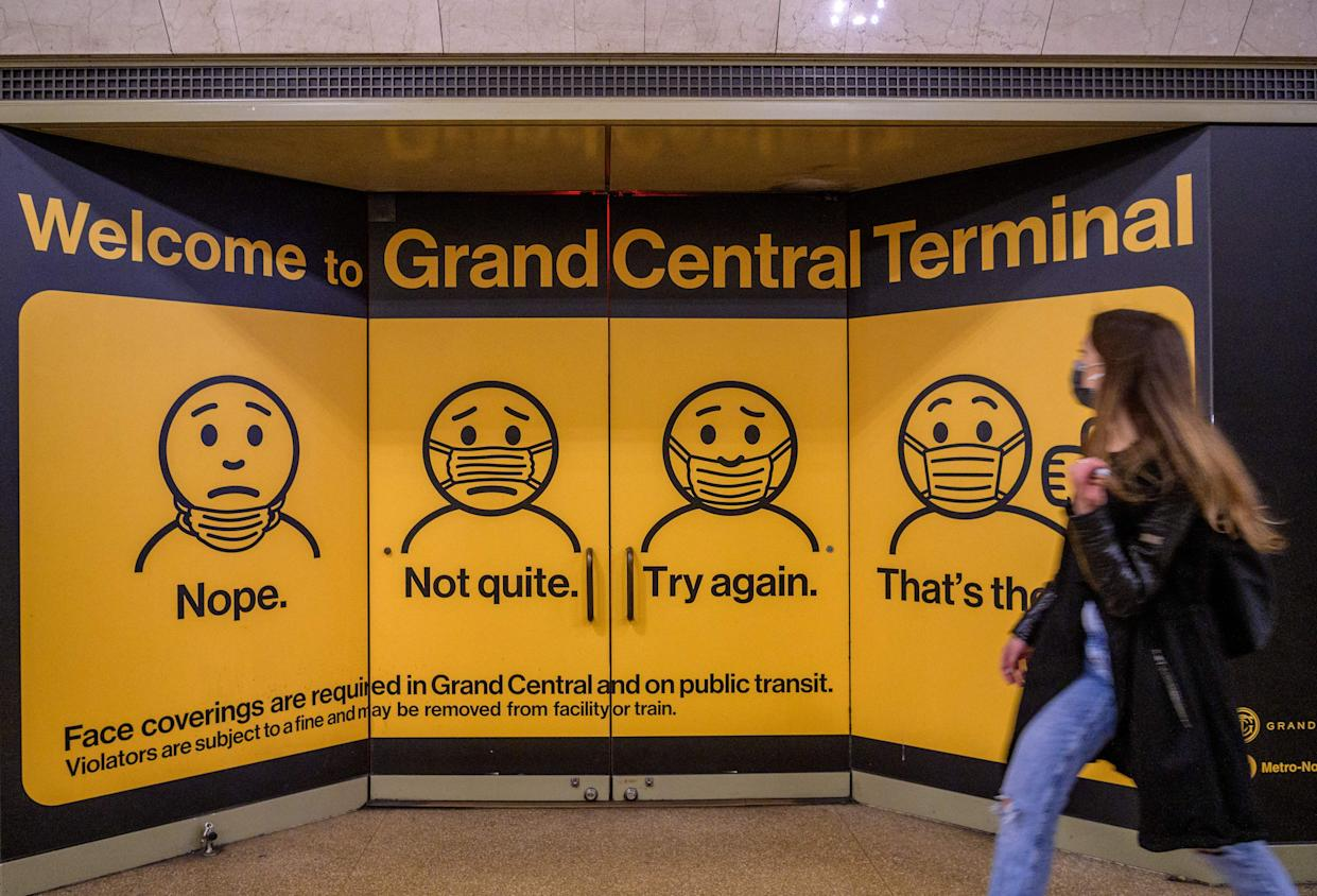 Posters at Grand Central Terminal train station in New York City show how to properly wear a face mask. (Angela Weiss/AFP via Getty Images)