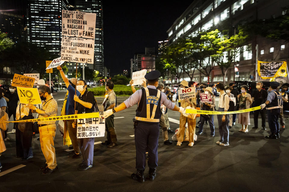 Activists march outside of the Olympic village only days before the start of the Tokyo Games.