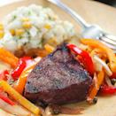 <p>Here, we toss colorful bell peppers in a balsamic-herb vinaigrette and grill them in a foil packet at the same time as the steak for a no-fuss dinner for two. Serve with corn on the cob.</p>