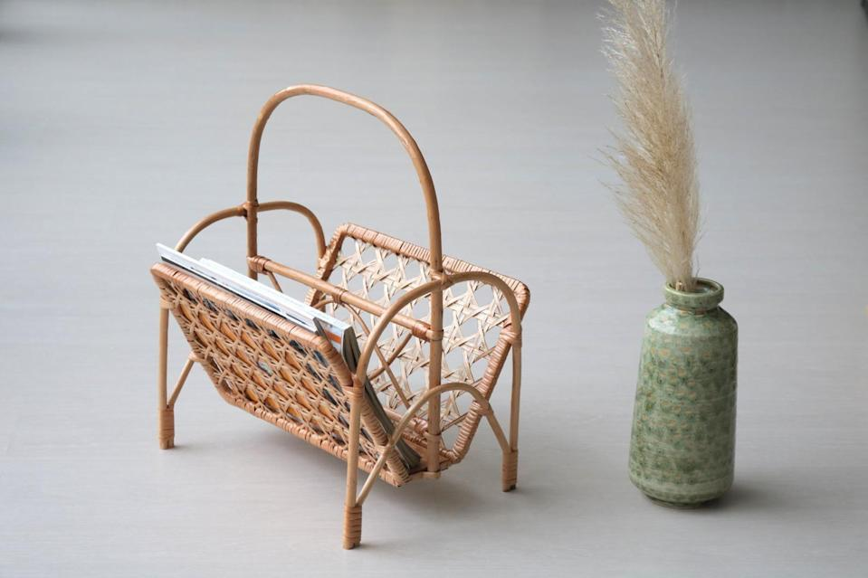 <p>This textured <span>Bamboo Magazine Rack</span> ($58) will look great next to your living room couch.</p>