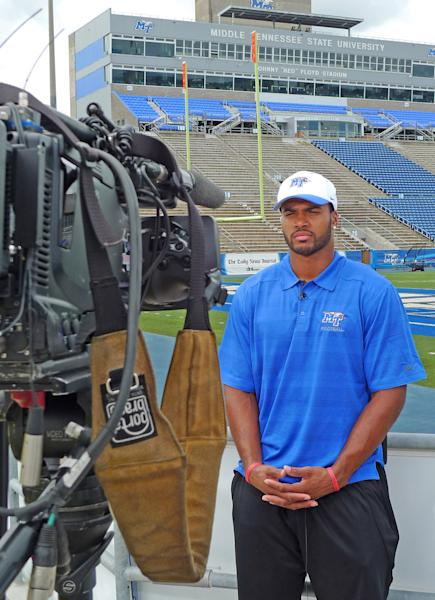 This Monday, Aug. 19, 2013 photo provided by Middle Tennessee State University shows NCAA college football player Steven Rhodes, a defensive end, during an interview in Murfreesboro, Tenn. The NCAA says it's working with Middle Tennessee and hasn't made a final decision on the eligibility of Rhodes, a freshman attempting to play after serving five years in the Marines. (AP Photo/Middle Tennessee State University)