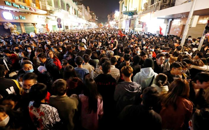 People gather on a street during New Year's Eve celebrations amid coronavirus pandemic in Hanoi - Reuters