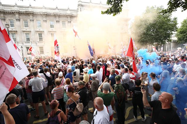 <p>Free Tommy Robinson supporters and pro-Trump supporters come together on Whitehall, London, for a joint rally in support of the visit of the U.S. president to the U.K. and calling for the release of jailed far-right activist Tommy Robinson. (Photo: Yui Mok/PA Images via Getty Images) </p>