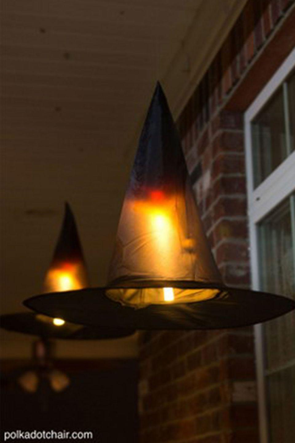 """<p>Light up the night with these magically spooky floating hats. Kids will love them! </p><p><strong>Get the tutorial at <a href=""""http://www.polkadotchair.com/2015/09/floating-witch-hat-luminaries.html/#_a5y_p=4332188"""" rel=""""nofollow noopener"""" target=""""_blank"""" data-ylk=""""slk:Polkadot Chair"""" class=""""link rapid-noclick-resp"""">Polkadot Chair</a>.</strong> </p>"""
