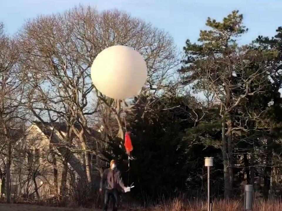 <p>Officials at the Chatham, Massachusetts, weather station on its final day </p> (US National Weather Service)