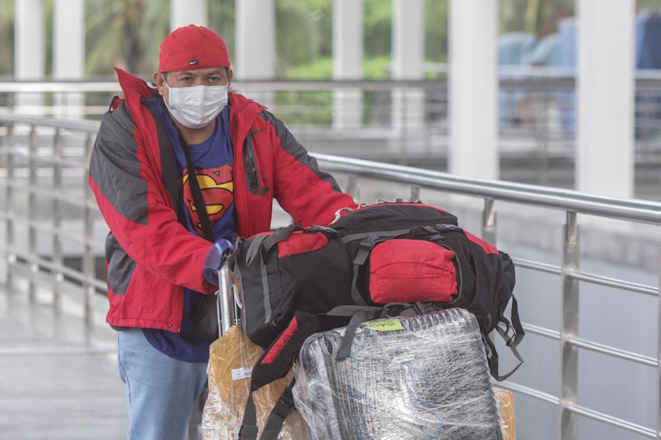 FILE PHOTO: An Overseas Filipino Worker (OFW) arrive at Ninoy Aquino International Airport Terminal 2 in Pasay, Metro Manila, Philippines on December 18, 2020. (Photo by Dante Diosina Jr/Anadolu Agency via Getty Images)