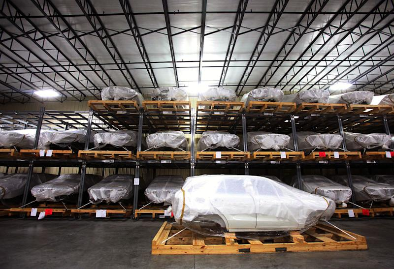 In this Aug. 13, 2012 photo, Mercedes SUV bodies are seen during a tour of the SKD packaging facility at BLG Logistics, Inc. in Vance, Ala. The U.S. economy is looking more resilient than many had thought, thanks in part to rising auto sales and another year-over-year surge in home prices on Tuesday, Oct. 2, 2012. (AP Photo/Tuscaloosa News, Dusty Compton)