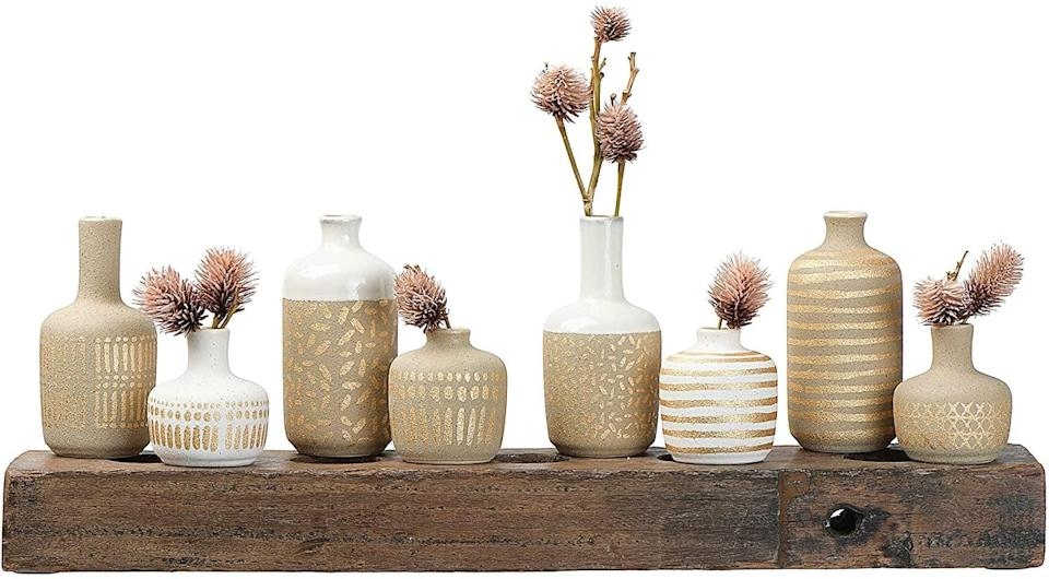 <p>From your desk to shelves, these <span>Main + Mesa Stoneware Vases</span> ($27 for eight) are perfect for adding a natural yet elegant touch to your home office. Fill these vases up with fresh or dried plants.</p>