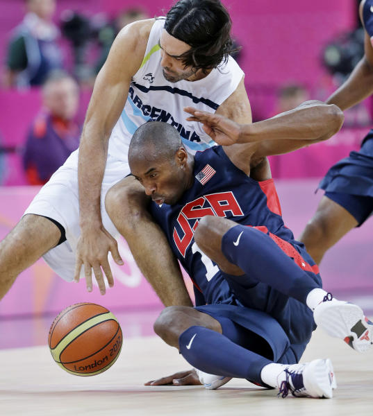 United States' Kobe Bryant, right, and Argentina's Luis Scola, left, chase a loose ball during a semifinal men's basketball game at the 2012 Summer Olympics, Friday, Aug. 10, 2012, in London. (AP Photo/Eric Gay)