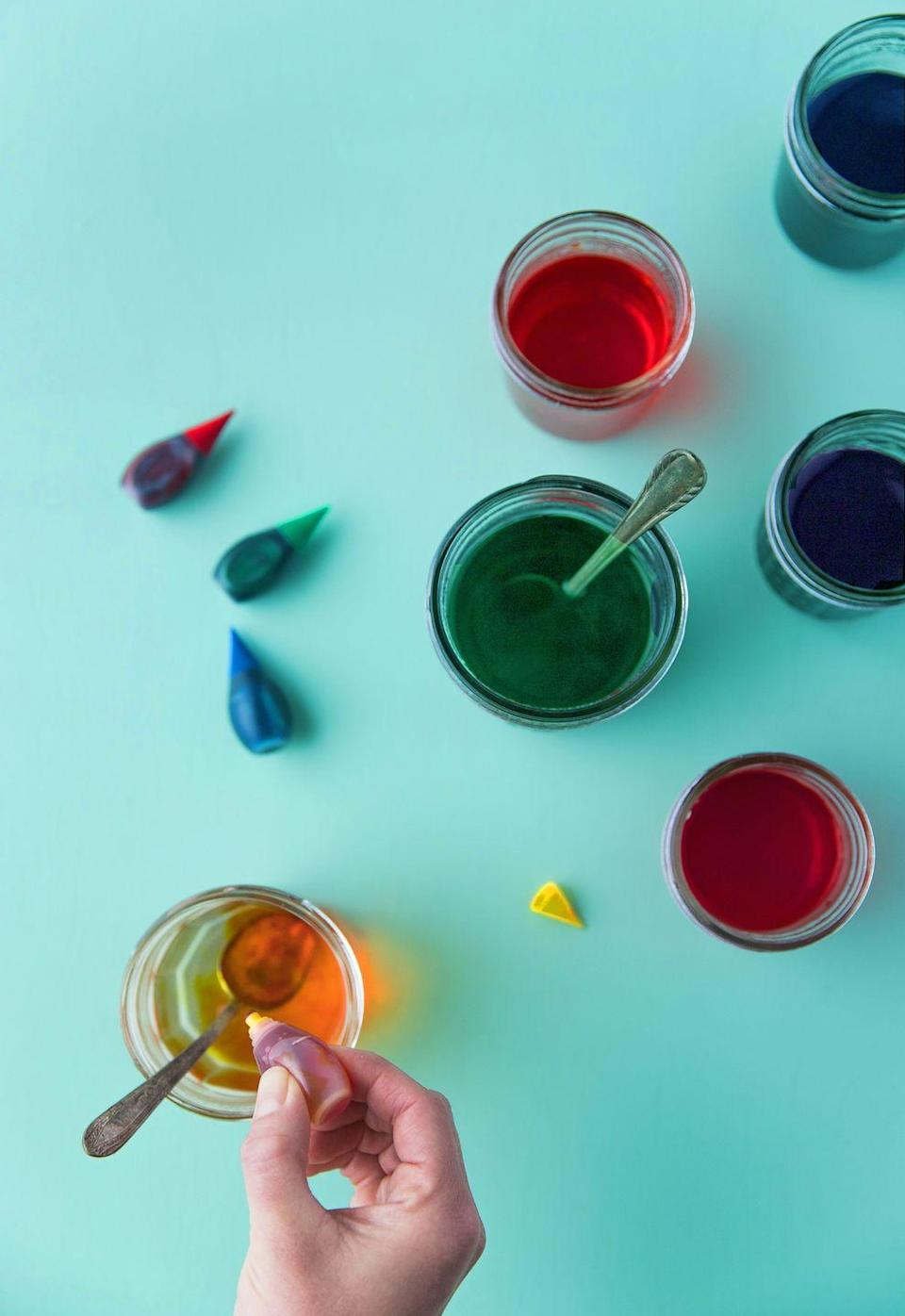 "<p>Bring the water back to a boil. Prep one small cup or glass for each color you'd like to use. Add one tablespoon of vinegar to each glass, and then pour in the boiling water.</p><p>For the brightest colors, add 10 drops of food coloring to each glass. (If you're mixing shades, use only five drops of each.) Stir until the dye is completely dissolved.</p><p><a class=""link rapid-noclick-resp"" href=""https://www.amazon.com/McCormick-SYNCHKG034068-Assorted-Food-Color/dp/B000V8BJVU/?tag=syn-yahoo-20&ascsubtag=%5Bartid%7C10050.g.26810304%5Bsrc%7Cyahoo-us"" rel=""nofollow noopener"" target=""_blank"" data-ylk=""slk:SHOP FOOD COLORING"">SHOP FOOD COLORING</a></p>"