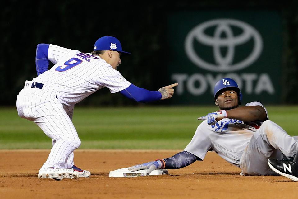 Javy Baez lets Yasiel Puig know he got him during Game 3 of the NLCS. (Getty Images)