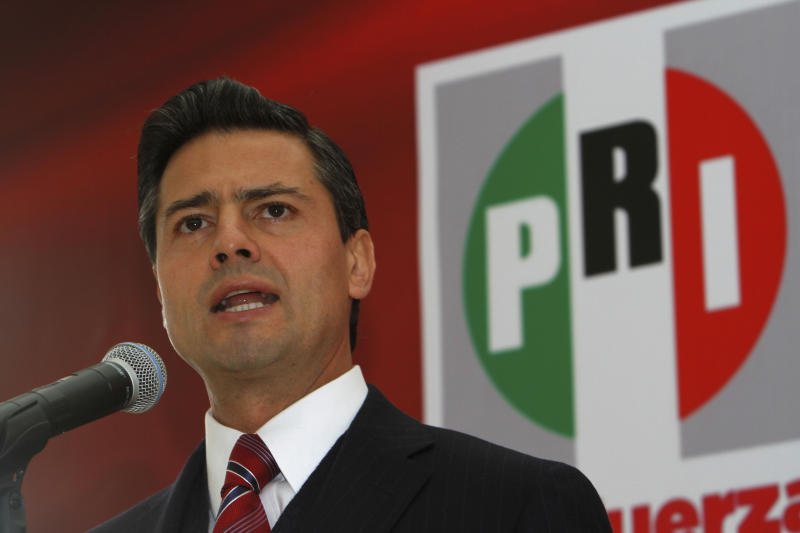 In this Jan. 5, 2012 photo, Enrique Pena Nieto, presidential candidate for the Revolutionary Institutional Party (PRI) speaks in Mexico City. The 2012 presidential race, which officially begins Friday March 30, 2012, is the PRI's race to lose. A dozen years ago, voters rose up and ended its 71-year iron grip on power, and many thought it had suffered its death knell. Elections are July 1. (AP Photo/Marco Ugarte)
