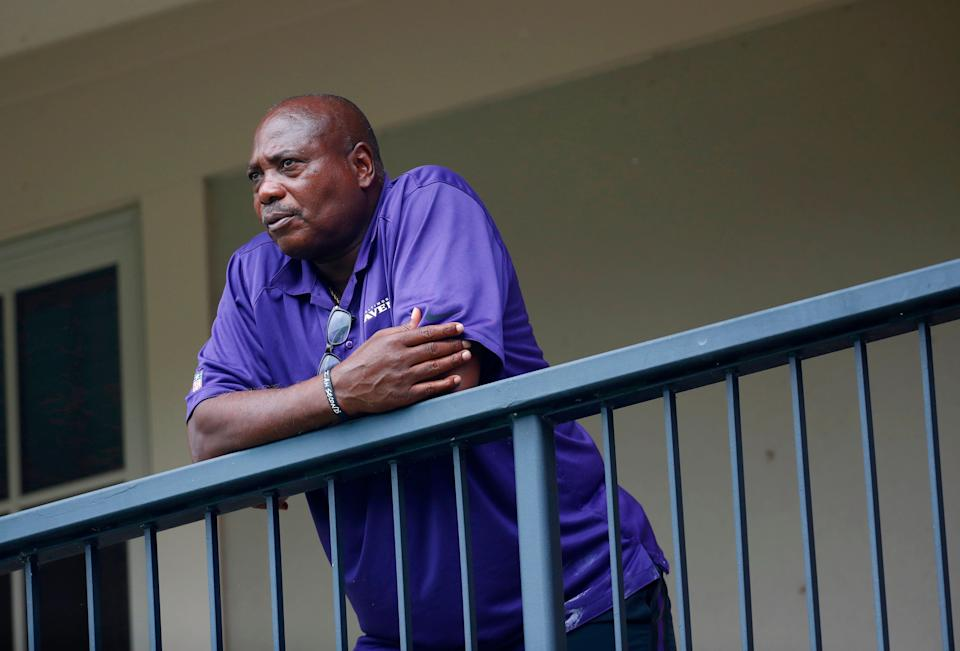 In this July 28, 2017, file photo, Baltimore Ravens general manager and executive vice president Ozzie Newsome looks out over practice fields following an NFL football training camp practice, in Owings Mills, Md.