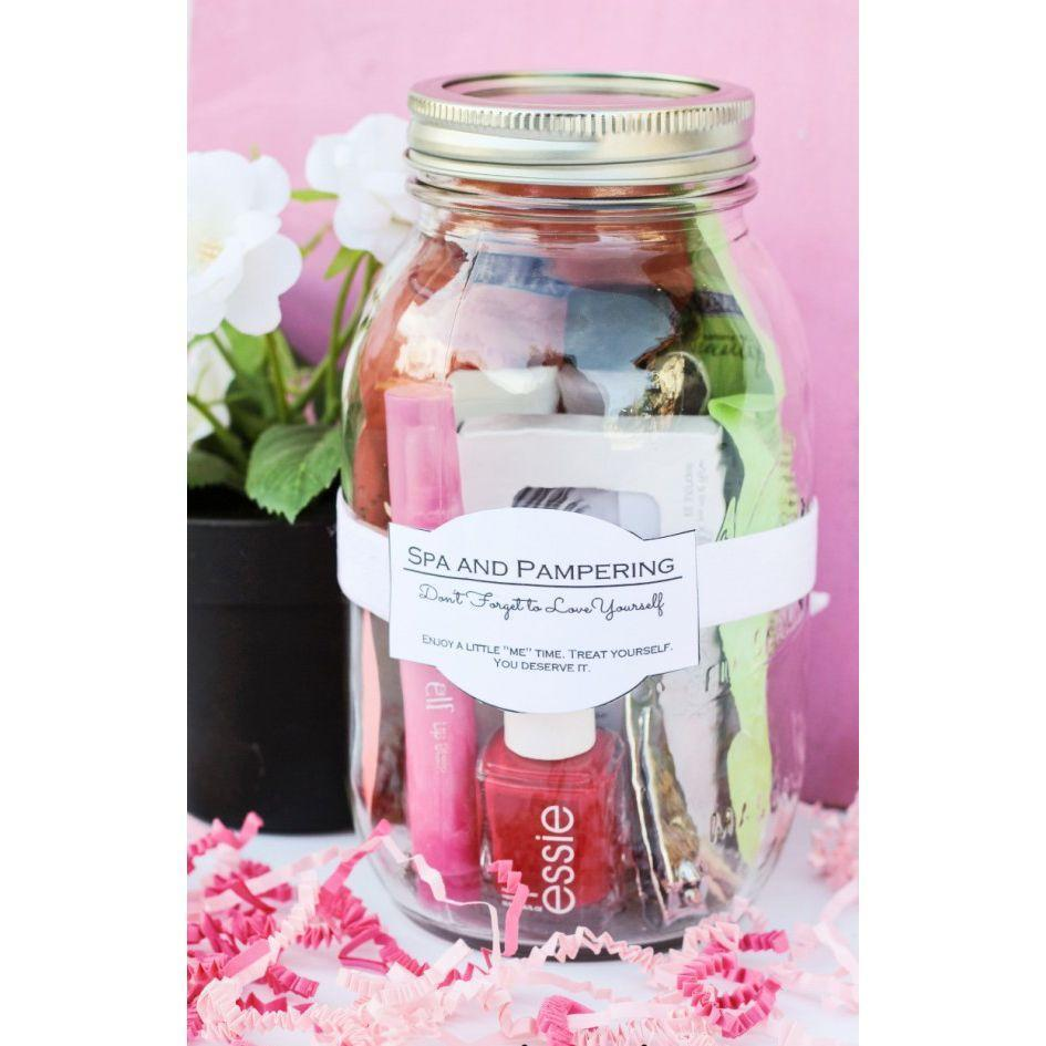 """<p>Pamper mom with her favorite products. You can even add a gift card to her favorite nail salon or spa to the jar. </p><p><em><strong>Get the tutorial from <a href=""""http://www.classyclutter.net/2014/02/spa-and-pampering-in-a-jar/"""" rel=""""nofollow noopener"""" target=""""_blank"""" data-ylk=""""slk:Classy Clutter"""" class=""""link rapid-noclick-resp"""">Classy Clutter</a>.</strong></em></p><p><strong><a class=""""link rapid-noclick-resp"""" href=""""https://www.amazon.com/Ball-Regular-32-Ounces-2-Units-Pack/dp/B01N6QBJG0/ref=sr_1_4?dchild=1&keywords=MASON+JAR&qid=1605822657&sr=8-4&tag=syn-yahoo-20&ascsubtag=%5Bartid%7C10063.g.34832092%5Bsrc%7Cyahoo-us"""" rel=""""nofollow noopener"""" target=""""_blank"""" data-ylk=""""slk:SHOP MASON JARS"""">SHOP MASON JARS</a></strong></p>"""