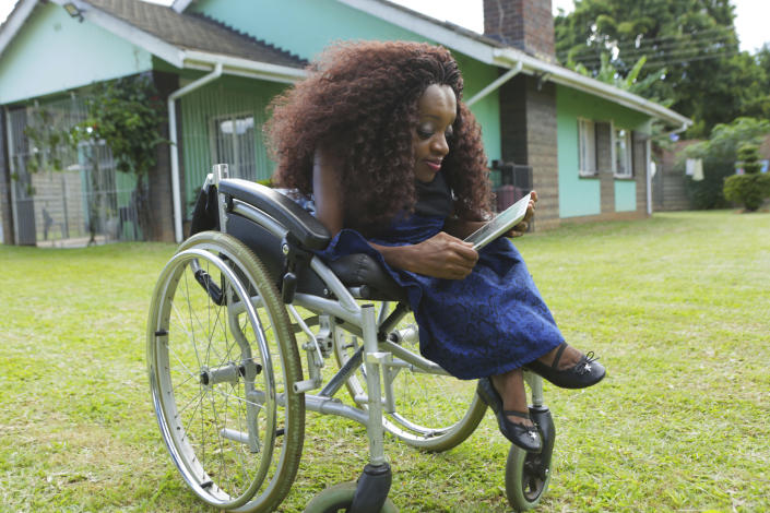 Florence Mudzingwa a digital marketer and life coach works from her wheelchair at her family home in Harare, in this Saturday, March 6, 2021 photo. Mudzingwa through her organisation Hope Resurrect Trust, equips girls with disability with skills, equipment and confidence to make their way in the world, despite their gender and disabilities. From driving trucks and fixing cars to encouraging girls living with disability to find their places in society, women in Zimbabwe are refusing to be defined by their gender or circumstances, even as the pandemic hits them hardest hardest and imposes extra burdens.(AP Photo/Tsvangirayi Mukwazhi)