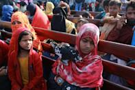 The Rohingya carried bags of belongings, toys and chickens as they sat on wooden benches during the three hour trip from Chittagong to Bhashan Char