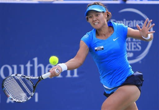 Li Na, of China, hits a forehand against Angelique Kerber, of Germany, during the women's final at the Western & Southern Open tennis tournament, Sunday, Aug. 19, 2012, in Mason, Ohio. (AP Photo/Al Behrman)