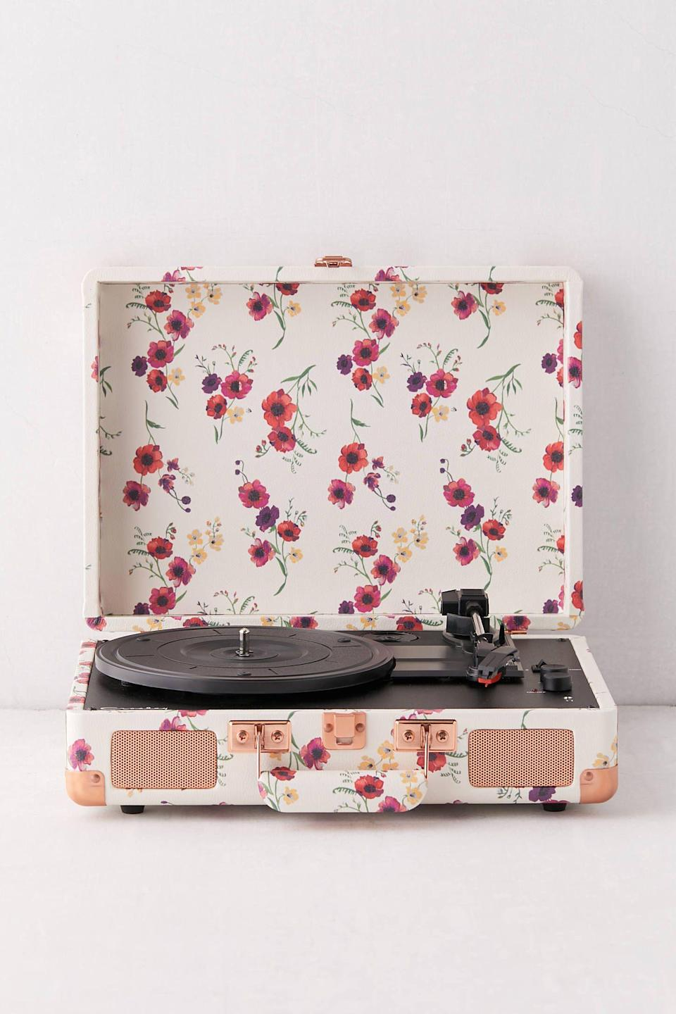 """<p><strong>Crosley</strong></p><p>urbanoutfitters.com</p><p><strong>$99.00</strong></p><p><a href=""""https://go.redirectingat.com?id=74968X1596630&url=https%3A%2F%2Fwww.urbanoutfitters.com%2Fshop%2Fcrosley-uo-exclusive-poppy-floral-cruiser-bluetooth-record-player&sref=https%3A%2F%2Fwww.countryliving.com%2Fshopping%2Fgifts%2Fg23480472%2Fteenage-girl-gifts%2F"""" rel=""""nofollow noopener"""" target=""""_blank"""" data-ylk=""""slk:Shop Now"""" class=""""link rapid-noclick-resp"""">Shop Now</a></p><p>It's a fact of life: teenagers play their music <em>way</em> too loud. At least now she can play your vinyl records in her room in style. </p>"""