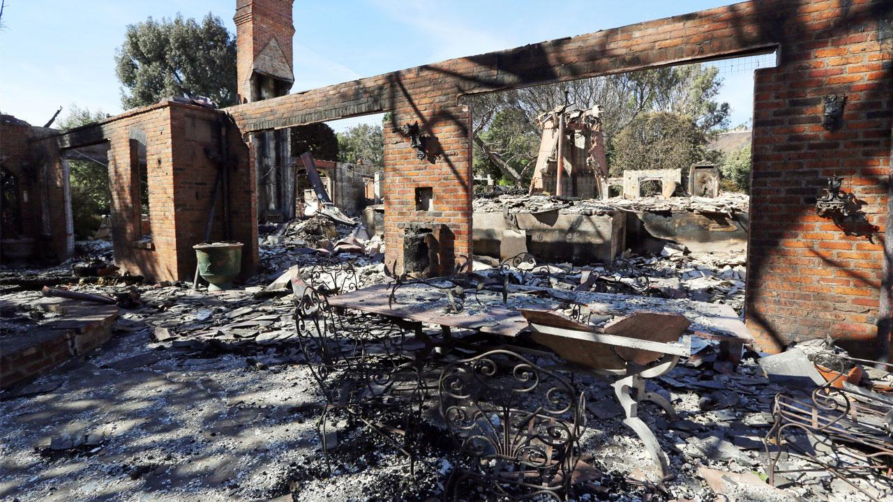 The deadly Woolsey Fire's containment level has risen to 69 percent as winds that fanned the destructive blaze were diminishing and resident were repopulating more areas.