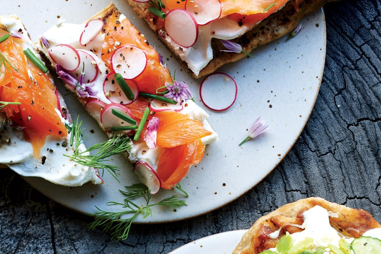 "You can make the dough, you can buy the dough, or you can simply assemble these same tasty toppings on slices of toasted country-style bread. <a href=""https://www.epicurious.com/recipes/food/views/flatbread-with-smoked-trout-radishes-and-herbs?mbid=synd_yahoo_rss"">See recipe.</a>"