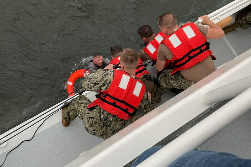 Coast Guard rescue a capsized 175-foot commerical lift boat south of Grand Isle