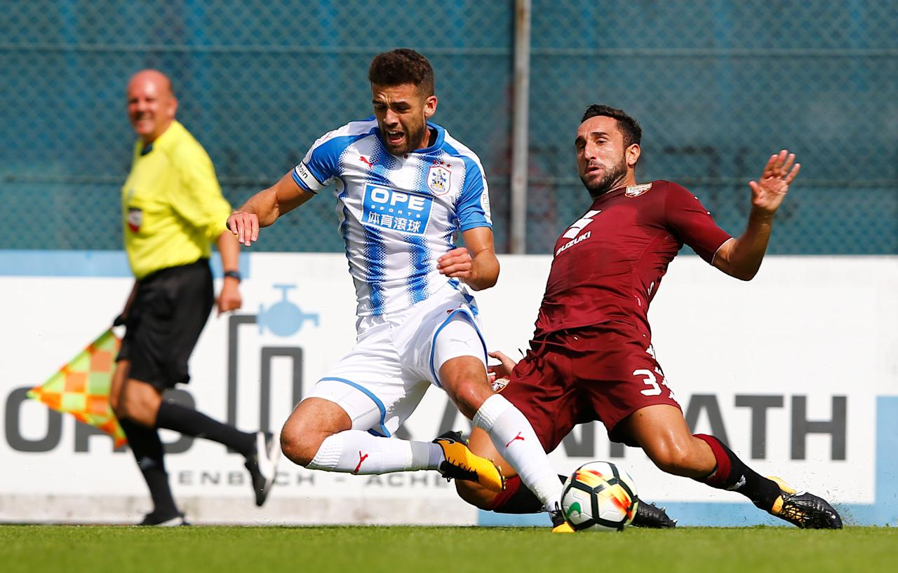 Soccer Football - Torino vs Huddersfield Town - Pre Season Friendly - Jenbach, Austria - August 4, 2017   Torino's Cristian Molinaro in action with Huddersfield Town's Tommy Smith   Action Images via Reuters/Dominic Ebenbichler