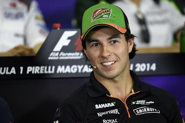 Force India's Mexican driver Sergio Perez attends a press conference at the Hungaroring circuit in Budapest on July 24, 2014, during the Hungarian Formula One Grand Prix. AFP PHOTO / DIMITAR DILKOFF (AFP Photo/DIMITAR DILKOFF)