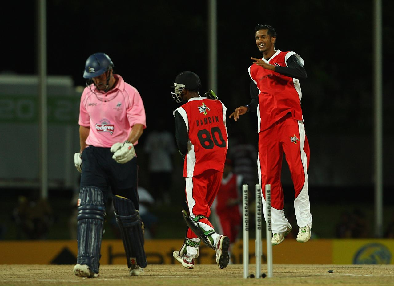 ST JOHNS, ANTIGUA AND BARBUDA - OCTOBER 27:  Sherwin Ganga of Trinidad celebrates taking the wicket of Andrew Strauss of Middlesex during the Stanford Twenty20 Super Series match between Trinidad & Tobago and Middlesex at the Stanford Cricket Ground on October 27, 2008 in St Johns, Antigua.  (Photo by Tom Shaw/Getty Images)