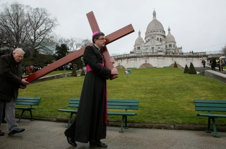 Eric de Moulins-Beaufort, the current head of the French conference of Catholic bishops, has called for demonstrations against the bill (AFP Photo/JACQUES DEMARTHON)