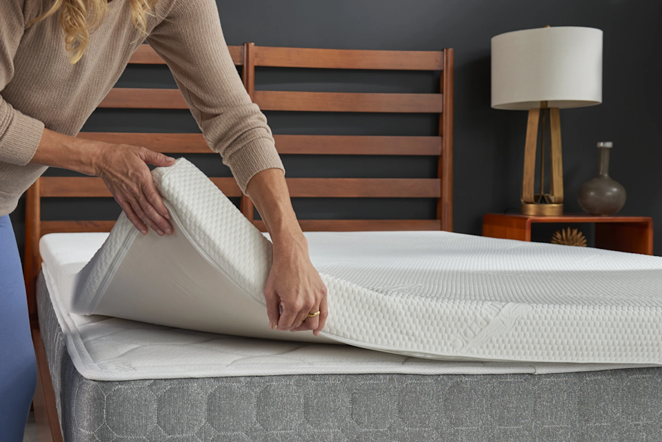 """<h3>Tempur-Pedic Temper-Topper Supreme</h3><br><strong>Best For:</strong> <strong>Personalized Supportive Sleep</strong><br>This mattress topper is made from 3 inches of you guessed it, the same stand-out TEMPUR® material that's found in all of Tempur-Pedic's legendary body forming mattresses. The topper adjusts to individual body weight, shape, and temperature for an unmatched personalized sleep experience. Added bonus, a removable and washable cover is included, which is resistant to mold and allergens. <br><br><strong>The Hype: 4.6 out of 5 stars</strong><br><br><strong>Sleepers Say:</strong> """"I absolutely love the 3 inch topper. Every night, I sink in feeling supported all around. I am definitely sleeping better - waking up less each night."""" <em>– Anonymous, Tempur-Pedic Reviewer</em><br><br><em>Shop <strong><a href=""""https://www.tempurpedic.com/other-products/tempur-topper-supreme/v/288/"""" rel=""""nofollow noopener"""" target=""""_blank"""" data-ylk=""""slk:Tempur-Pedic"""" class=""""link rapid-noclick-resp"""">Tempur-Pedic</a></strong></em><br><br><br><strong>Tempur-Pedic</strong> TEMPUR-Topper Supreme, $, available at <a href=""""https://go.skimresources.com/?id=30283X879131&url=https%3A%2F%2Fwww.tempurpedic.com%2Fother-products%2Ftempur-topper-supreme%2Fv%2F288%2F"""" rel=""""nofollow noopener"""" target=""""_blank"""" data-ylk=""""slk:Tempur-Pedic"""" class=""""link rapid-noclick-resp"""">Tempur-Pedic</a>"""
