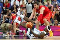 LONDON, ENGLAND - AUGUST 12: Pau Gasol #4 of Spain hussles for the ball against LeBron James #6 of the United States during the Men's Basketball gold medal game between the United States and Spain on Day 16 of the London 2012 Olympics Games at North Greenwich Arena on August 12, 2012 in London, England. (Photo by Christian Petersen/Getty Images)