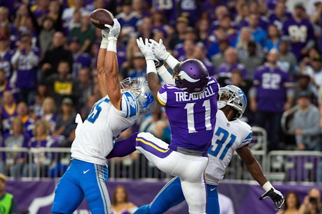 <p>Detroit Lions defensive back Miles Killebrew (35) breaks up a pass to Minnesota Vikings wide receiver Laquon Treadwell (11) in the second quarter at U.S. Bank Stadium. Mandatory Credit: Brad Rempel-USA TODAY Sports </p>