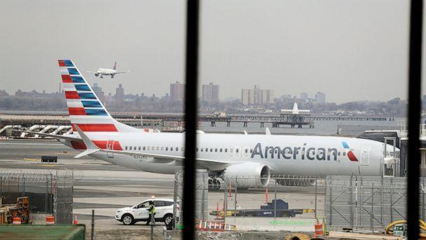 PHOTO: In a March 13, 2019 file photo, an American Airlines Boeing 737 MAX 8 sits at a boarding gate at LaGuardia Airport in New York. (AP Photo/Frank Franklin II)