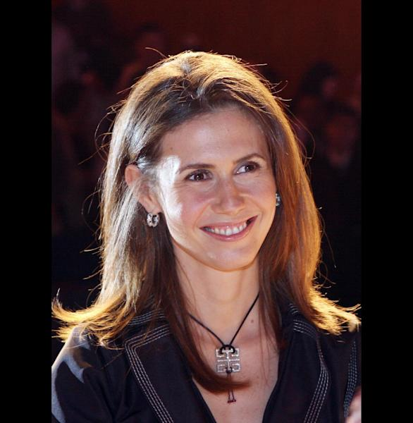 FILE - Asma Assad, the wife of Syrian President Bashar Assad, poses for the camera on in this May 20, 2007 file photo. An EU official said Thursday March 23, 2012 a total of four members of the Assad family, along with eight government ministers, will be targeted in the latest round of sanctions aimed at stopping the violent crackdown on members of the Syrian opposition. (AP Photo, File)