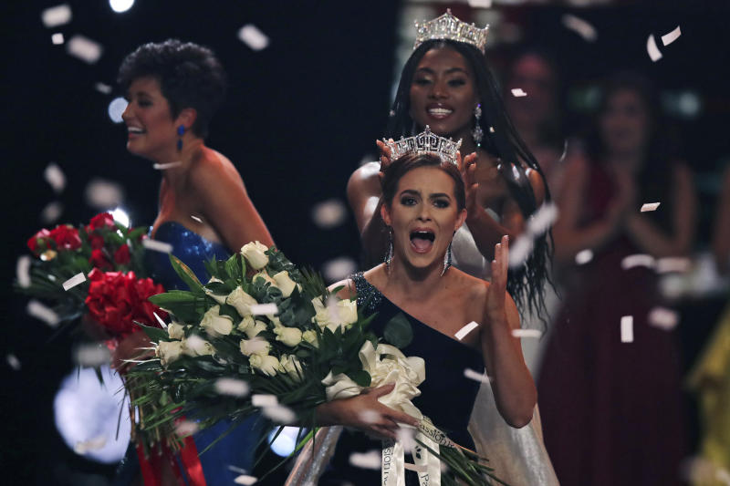 Camille Schrier of Virginia was crowned Miss America 2020 at the Mohegan Sun casino in Uncasville, Conn., on Thursday. At left is runner-up Miss Georgia Victoria Hill, and behind Schrier is Miss America 2019 Nia Franklin. (Photo: AP Photo/Charles Krupa)