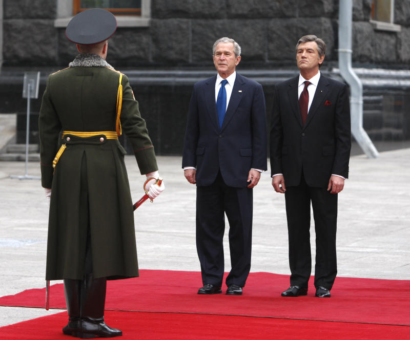 Former U.S. President George W. Bush and Ukraine's then-President Viktor Yushchenko attend an official welcoming ceremony in Kiev on April 1, 2008. (Gleb Garanich/Reuters)