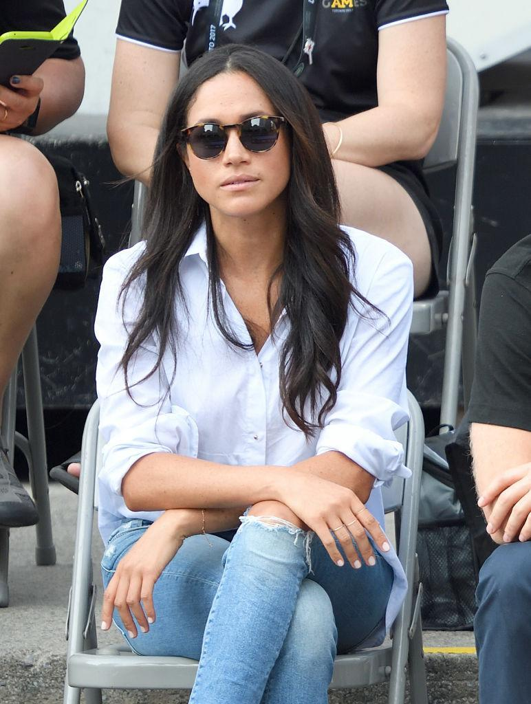 Markle first officially appeared with Prince Harry at the Invictus Games, rocking natural nails and a casual look. (Photo: Getty Images)