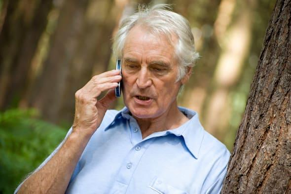 BDCJMH mature man using mobile phone in forest. Image shot 2009. Exact date unknown. mature; man; using; mobile; phone; forest;