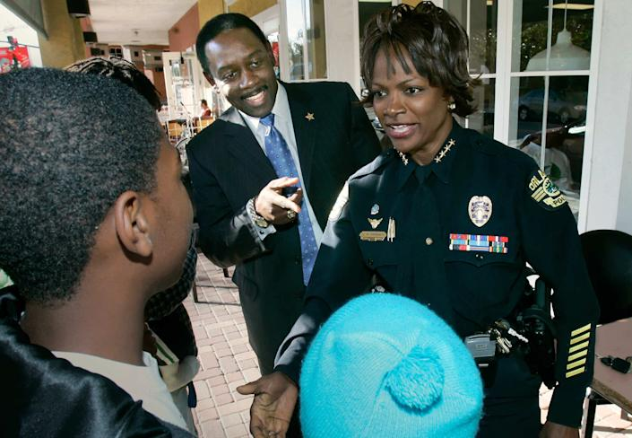 Orlando Police Chief Val Demmings and her husband Jerry Demmings, who will be sworn in as Orange County Sheriff, greet a group of children that wanted to meet them while they were having lunch together in December 2008.