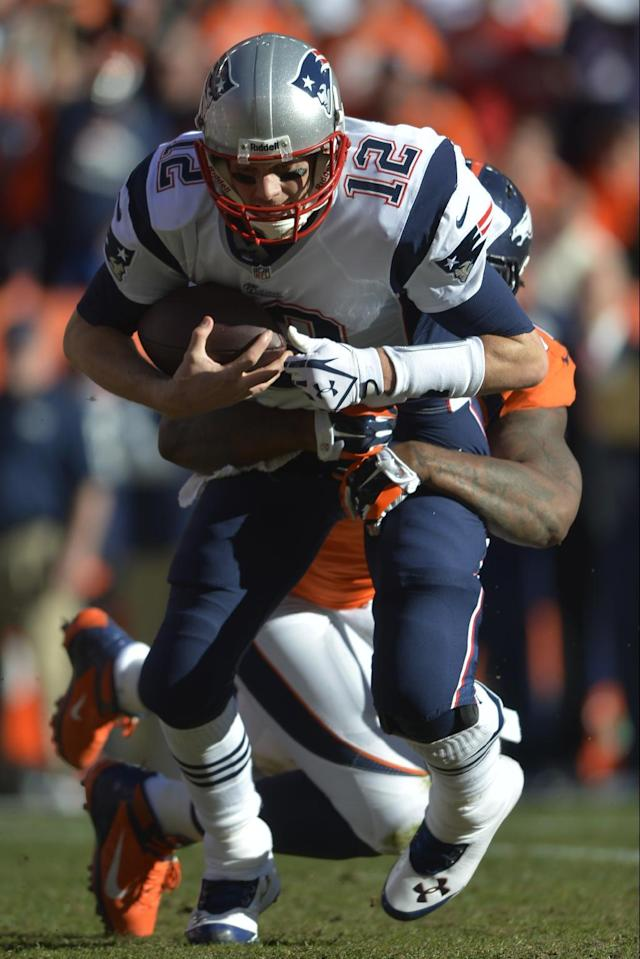 New England Patriots quarterback Tom Brady (12) is sacked by Denver Broncos defensive end Robert Ayers (91) during the first half of the AFC Championship NFL playoff football game in Denver, Sunday, Jan. 19, 2014. (AP Photo/Jack Dempsey)