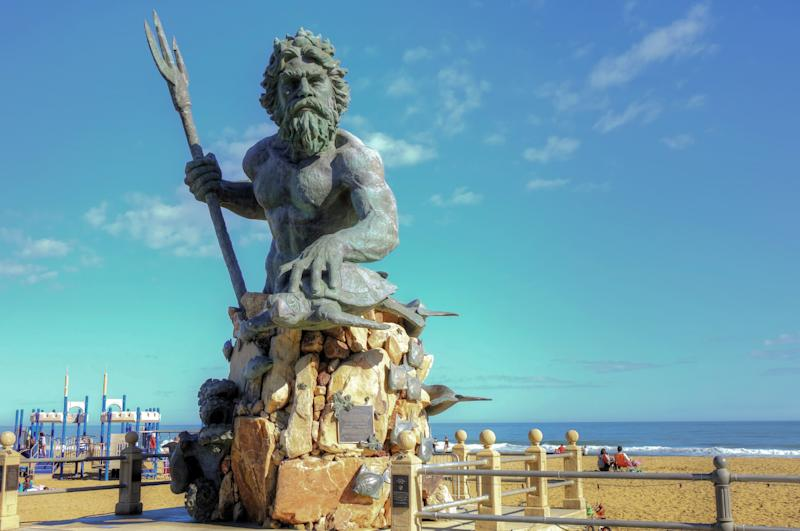 The statue of King Neptune, Virginia Beach Boardwalk | ABEMOS—Shutterstock
