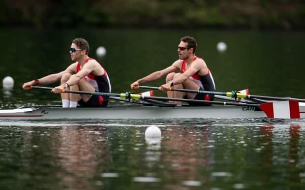 Canada's Maxwell Lattimer, left, and Patrick Keane are shown in competition at the 2021 Olympic Qualification Regatta in Lucerne, Switzerland. On Sunday, the duo qualified a boat for Canada at the Tokyo Games. (Daniel Kopatsch/Getty Images - image credit)