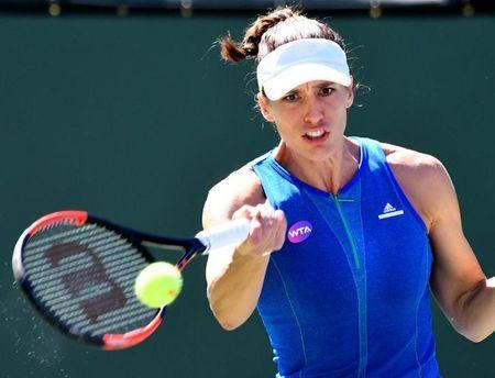 Mar 11, 2017; Indian Wells, CA, USA; Andrea Petkovic (GER) returns during her second round match against Angelique Kerber (not pictured) in the BNP Paribas Open at the Indian Wells Tennis Garden. Kerber won 6-2, 6-1. Mandatory Credit: Jayne Kamin-Oncea-USA TODAY Sports