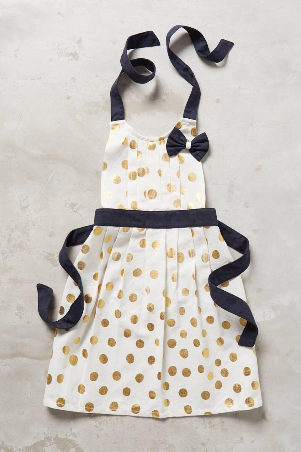 """<p><strong>Anthropologie</strong></p><p>anthropologie.com</p><p><strong>$24.00</strong></p><p><a href=""""https://go.redirectingat.com?id=74968X1596630&url=https%3A%2F%2Fwww.anthropologie.com%2Fshop%2Fgold-polka-dotted-kids-apron-2&sref=https%3A%2F%2Fwww.townandcountrymag.com%2Fleisure%2Fdining%2Fg29576420%2Fcooking-gifts%2F"""" rel=""""nofollow noopener"""" target=""""_blank"""" data-ylk=""""slk:Shop Now"""" class=""""link rapid-noclick-resp"""">Shop Now</a></p><p>Who says functional can't be fashionable? Keep the baker in your life covered with this stylish apron. </p>"""