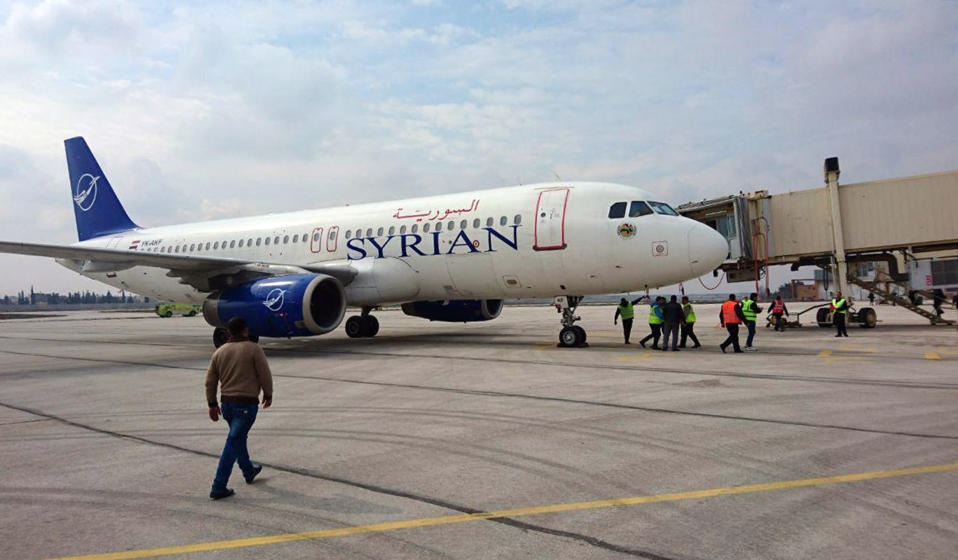 This photo released by the Syrian official news agency SANA, shows a Syrian commercial plane carrying Syrian officials and journalists after it landed at Aleppo airport, Syria, Wednesday, Feb. 19, 2020. The Syrian commercial flight on Wednesday from Damascus, marked the resumption of internal flights between Syria's two largest cities for the first time since 2012. (SANA via AP)