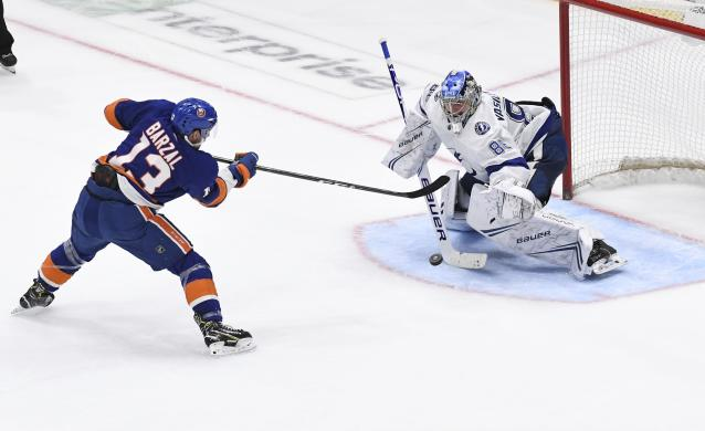 New York Islanders' Mathew Barzal (13) is unable to score on Tampa Bay Lightning goaltender Andrei Vasilevskiy (88) during the shootout in an NHL hockey game Friday, Feb. 1, 2019, in Uniondale, N.Y. The Lightning won 1-0. (AP Photo/Kathleen Malone-Van Dyke)