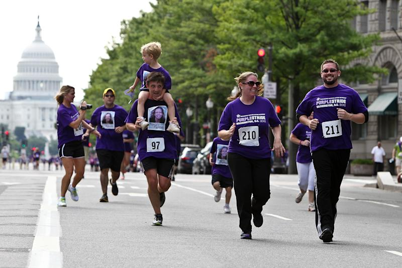 Runners approach the finish line at the Pancreatic Cancer Action Network's PurpleStride 5K Run/Walk on June 16, 2012. (Paul Morigi via Getty Images)