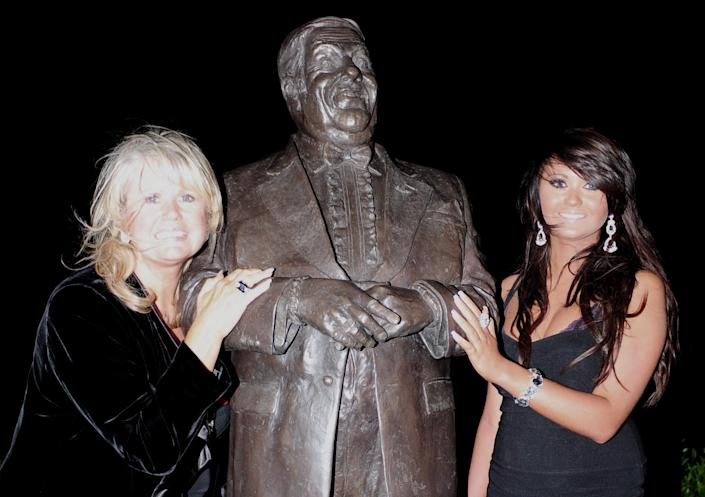 A statue of comedian Les Dawson is unveiled by his widow Tracy Dawson, left and daughter Charlotte, at St Annes Pier, Lytham St Annes, Lancashire.   (Photo by Anna Gowthorpe - PA Images/PA Images via Getty Images)