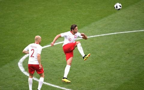 Grzegorz Krychowiak of Poland makes a pass - Credit: GETTY IMAGES