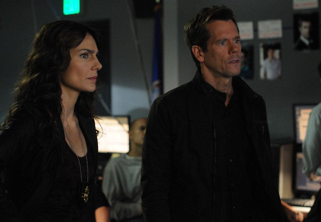 "FBI Specialist Parker (Annie Parisse) and Ryan Hardy (Kevin Bacon) gather more clues to uncover a case in the ""The Siege"" episode of ""The Following."""